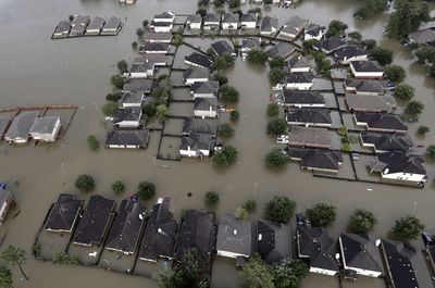 Homes are surrounded by floodwaters on Aug. 29, 2017, in Spring, Texas.