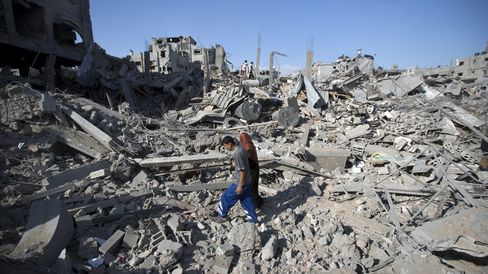 Palestinian Searching Building Debris in Shejaiya