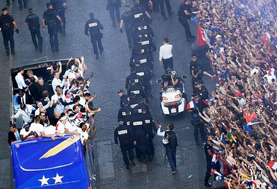 Macron, Paris Fans Greet French National Soccer Team Winners