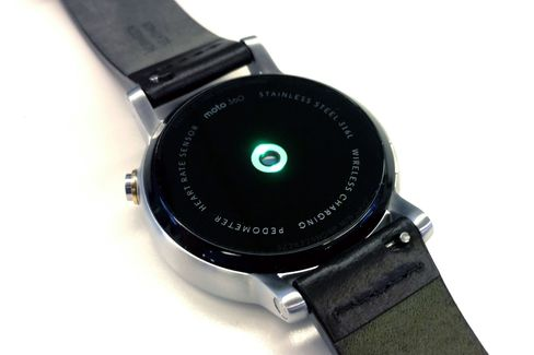 The green light is the heart rate sensor at work on the watch's rear.