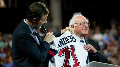 Senator Bernie Sanders receives a Liberty University jersey from Jerry Falwell Jr., president of the Lynchburg, Virginia, school, onMonday.