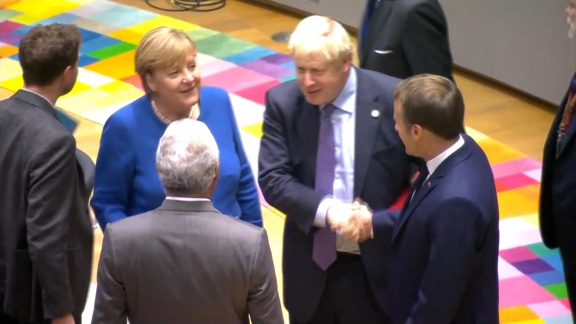 Boris Johnson EU Victory Lap: Back-Slaps, High-Fives, Bro-Hugs From Merkel, Macron, Tusk and Others