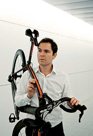 Bradley with one of the bikes he designed for Specialized