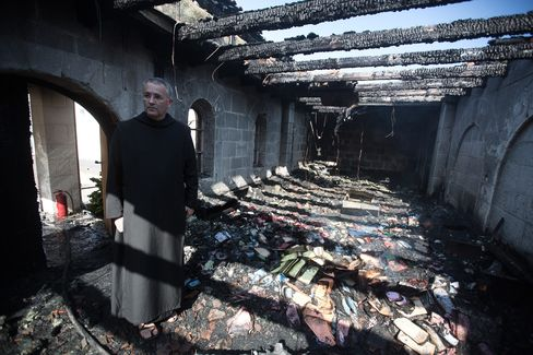 A Priest Inspects Damage at Tabgha Church