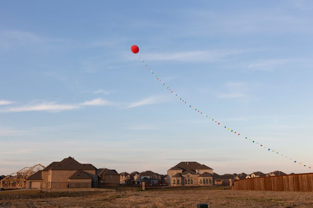 A Large Balloon Floats Over S Office At Creeks Of Legacy Housing Development