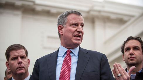 New York City mayor-elect Bill de Blasio and a group of newly-elected mayors from across the country speak to the media outside of the West Wing of the White House in Washington, D.C., U.S., on Friday, Dec. 13, 2013.