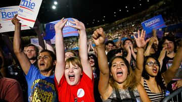 Supporters hold signs and cheer for Democratic presidential candidate Bernie Sanders during a campaign event at the Los Angeles Memorial Sports Arena on Aug. 10, 2015.