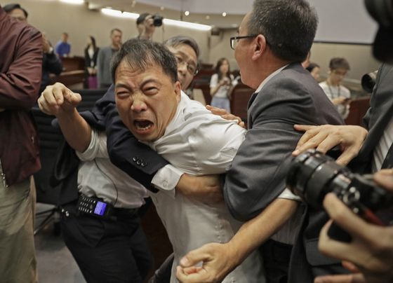 Hong Kong Lawmakers Told to Behave After Extradition Law Brawl
