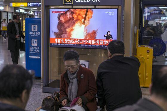 North Korea's Kim Tests Trump's Limits With Rockets, Taunts
