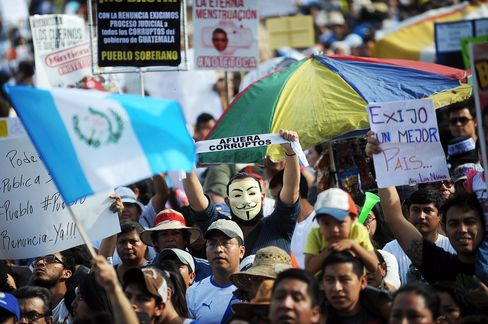 Protesters in Guatemala City on May 30, 2015.