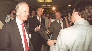 Senator Bob Packwood is surrounded by members of the media on Capitol Hill on May 18, 1995.