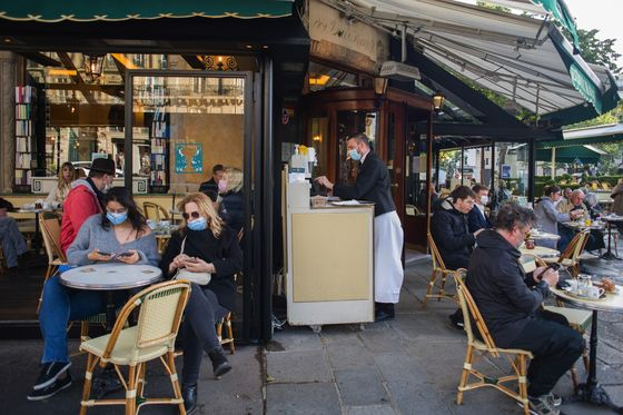 No Masks for Vaccinated Amazon Staff; Paris Cafes: Virus Update