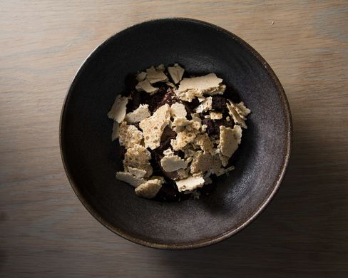 A peek at the chocolate and coffee dessert, hiding a butterscotch-like layer of lúcuma.