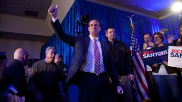 Republican presidential hopeful Rick Santorum walks on stage before addressing a crowd at the Stoney Creek Inn on Jan. 3, 2012, in Johnston, Iowa.