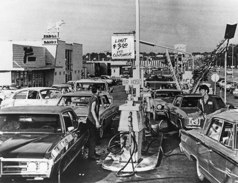Drivers line up for fuel at a U.S. gas station during the worldwide fuel shortages caused by the oil embargo imposed by OPEC, circa 1974.