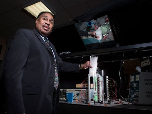 American theoretical physicist Dr. Ronald Mallett pours dry ice into a ring laser at a laboratory at the University of Connecticut on March 23, 2015.