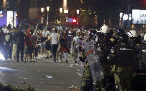 Serb President Wavers on Virus Curfew After Violent Protests