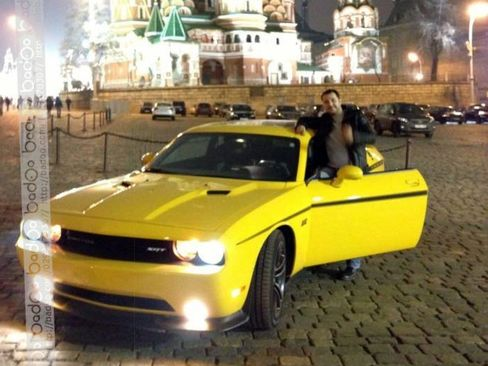 Roman Seleznev poses with his yellow Dodge Challenger SR automobile in front of the Kremlin, in Moscow, Russia, in this undated handout photo taken from his mobile phone and used in U.S. government court documents, and released to the media on March 10, 2015.