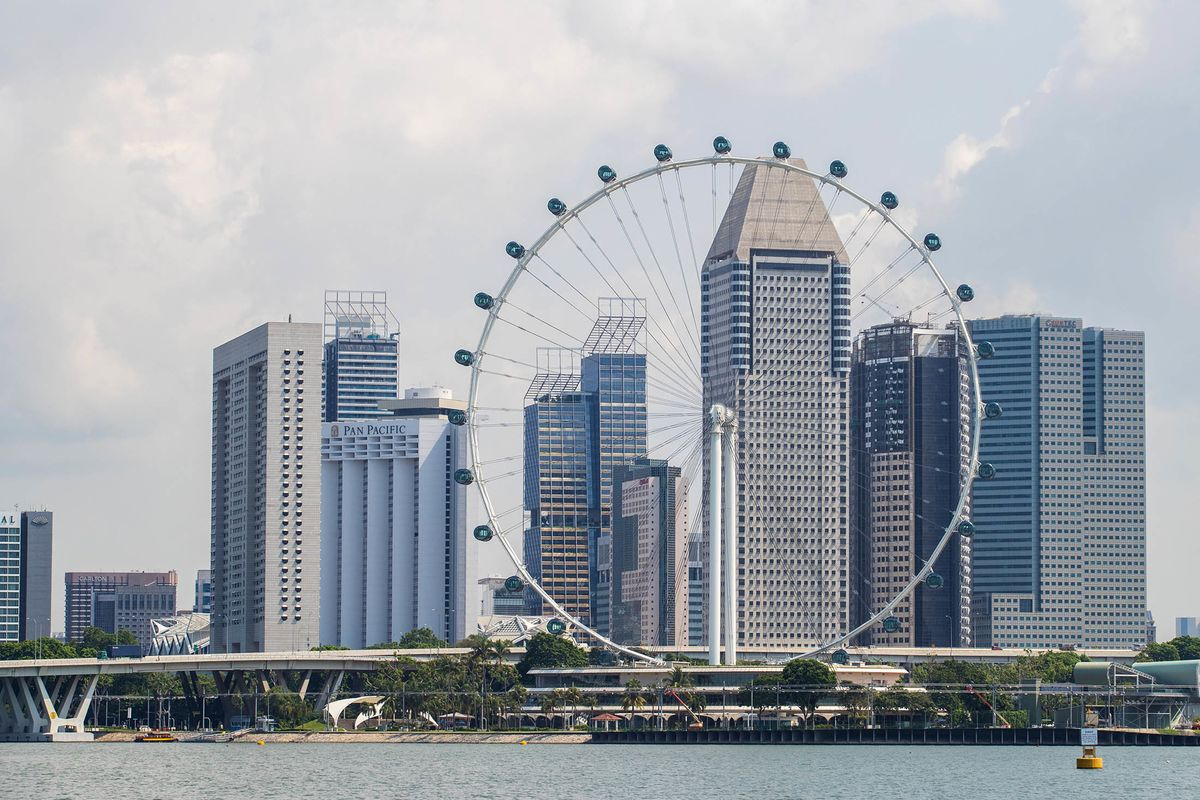 Bonuses Paid to Singapore Banks for Selling Risky Debt Under Scrutiny