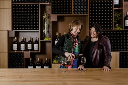 Winemaker and general manager Marjolaine Maurice de Coninck, head of the female team making the wine at ChâteauMarquis d'Alesme, pours wine for owner Nathalie Perrodo-Samani in the new tasting room at the chateau.