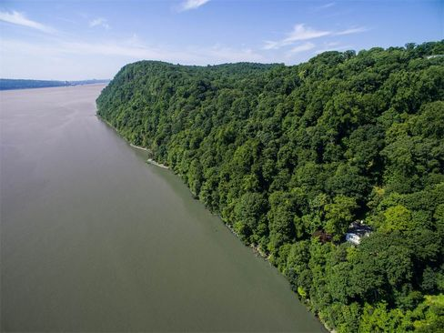 "Snedens Landing's ""Cliff House"" looks out over the Hudson River from its wooded Palisades perch."