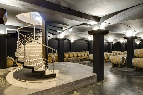 The new cellar at Chateau Tour Saint Christophe holds dozens of barrels of 2015 red wine.