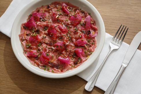 The beef crudo, carved from aged eye-of-round, derives additional color from watermelon radishes.