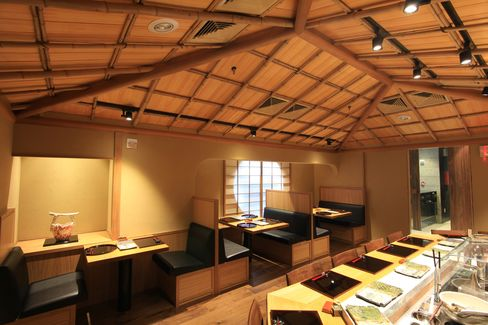 The main dining room at Tempura Matsui includes counter seating and a few booths.