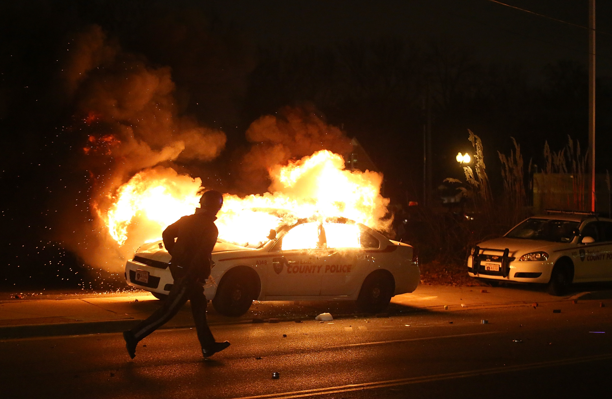 Some of the worst displays of unrest included burning police cars and a Little Caesar's pizza shop, looting, and scattered gunshots.