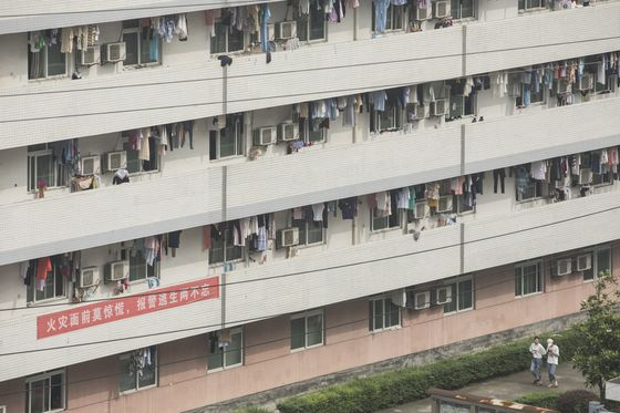 A 9,500% Stock Surge Turns Janitors Into Millionaires in China