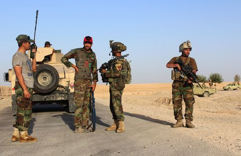Afghan National Security Forces patrol after recent clashes on Aug 12.