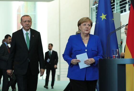 Merkel and Erdogan Clash in Berlin Over Turkish Reporter