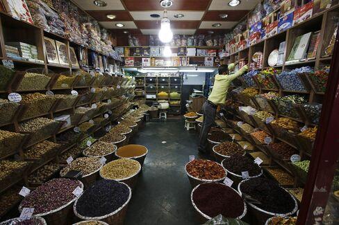 A spice seller adjusts his display at his store inside the Tajrish bazaar in Tehran.
