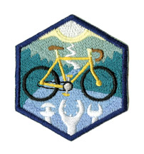 More conventional badges are given for activities such as restoring an old bike