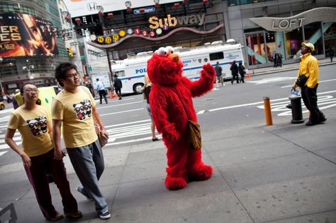 Tourists, Police, and Elmo Tangle in Times Square