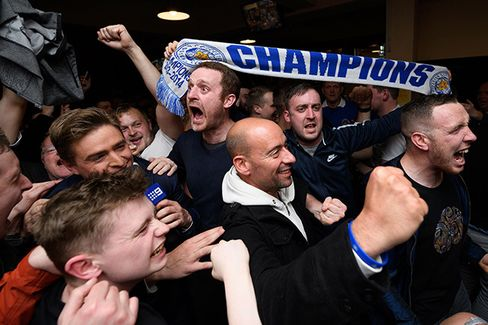 Leicester City fans celebrate on May 2.