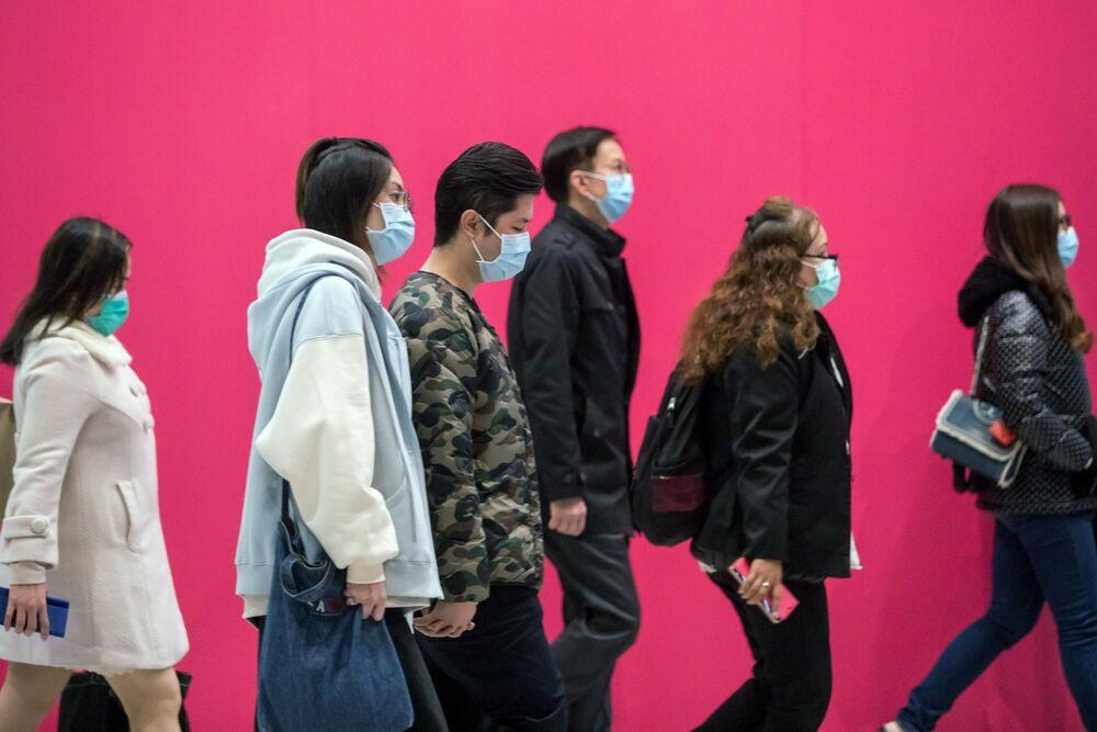 Pedestrians wearing protective masks walk along a road in Hong Kong on Jan. 31.