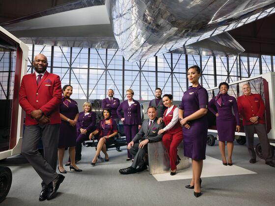 Delta Unveils Zac Posen Uniforms With a Taste of `Passport Plum'