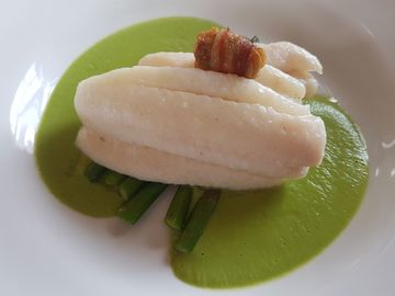 Lemon sole fillets with pea sauce and angel on horseback at The Sportsman.