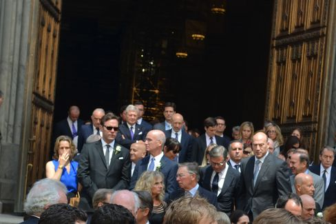 Jerry Speyer, co-CEO of Tishman Speyer, Lloyd Blankfein, CEO of Goldman Sachs Group Inc., Mike Ovitz, and Gary Cohn, president of Goldman, are seen exiting a memorial mass for James B.
