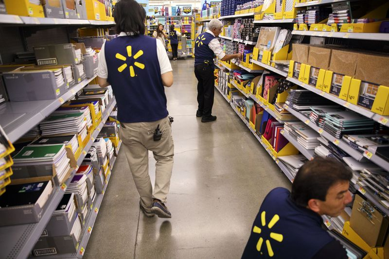 wal mart will allow workers to have early access to pay bloomberg