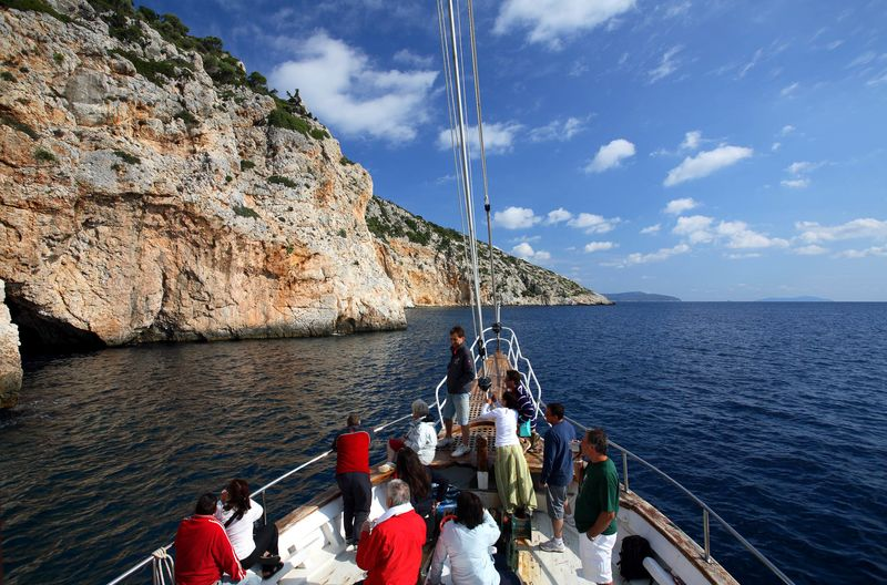 People. tourists on a boat. sailing ship. the Blue Cave in the sea of Alonissos Marine Park. Sporades Islands. Greece