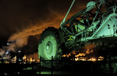 A disused mining machine is displayed in front of an oil sands extraction facility near the town of Fort McMurray, Alberta, Canada. Photographer: Mark Ralston/AFP via Getty Images