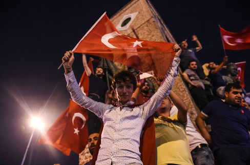 Pro-Erdogan supporters gather at Taksim square in Istanbul to support the government on July 16, 2016.