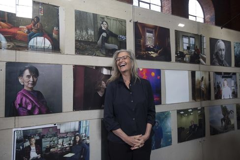 Annie Leibovitz poses with her photographs at the launch of Women: New Portraits, on view in London until Feb. 7. The international touring exhibition was commissioned by UBS.