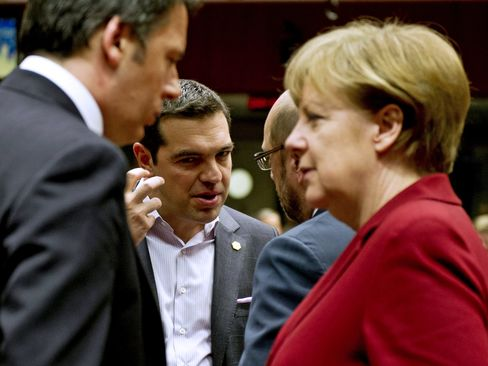 Greece's Prime minister Alexis Tsipras and Germany's Chancellor Angela Merkel before a working session during an European Council summit in Brussels on March 19, 2015.