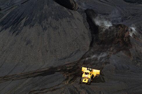 A bulldozer moves coal at a coal mine in Carlinville, Ill.