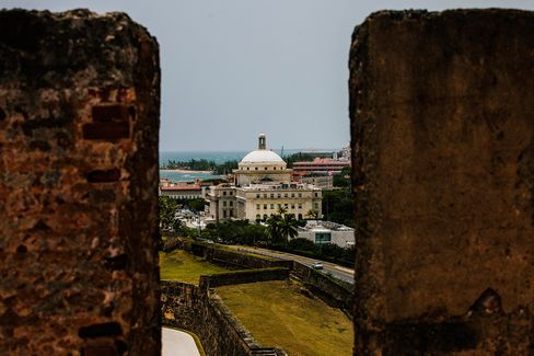 The Capitol Building is seen past walls in the Old City of San Juan, Puerto Rico, on July 8, 2015.