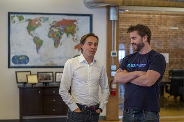 Ryan Petersen, chief executive officer and founder of Flexport Inc., right, speaks with Sanne Manders, chief operating officer of Flexport Inc., at the company's office in San Francisco, California, U.S., on Wednesday, April 15, 2015. Flexport Inc. helps companies ship goods internationally. Photographer: David Paul Morris/Bloomberg *** Local Caption *** Ryan Peterson;Sanne Manders