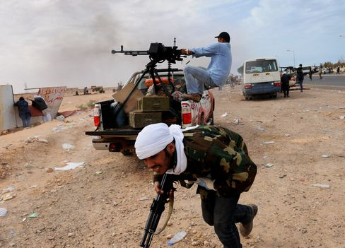 Qaddafi Mounts Offensive as NATO Holds Back on No-Fly Zone
